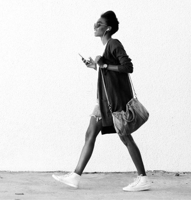 Trendy African woman walking